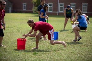 students playing water games