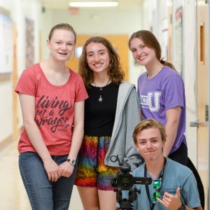 Students with camera smiling